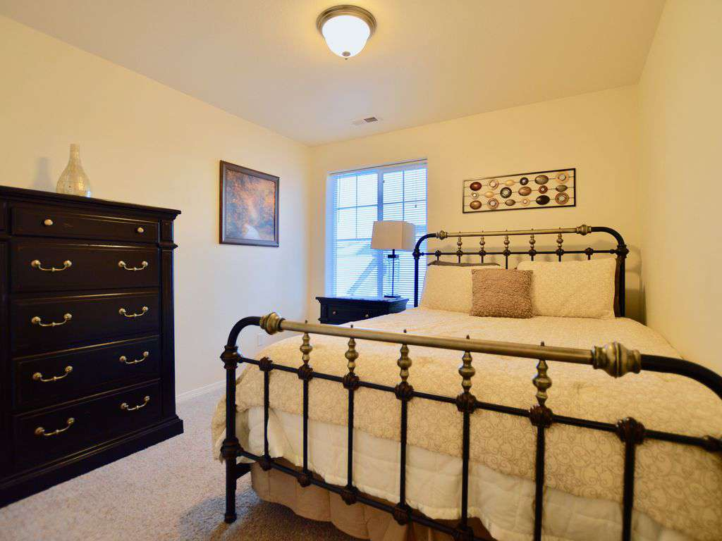 Plush queen bed with large dresser.