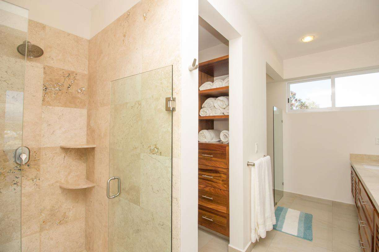 Master ensuite with closet area, spacious shower, water closet & dual sinks