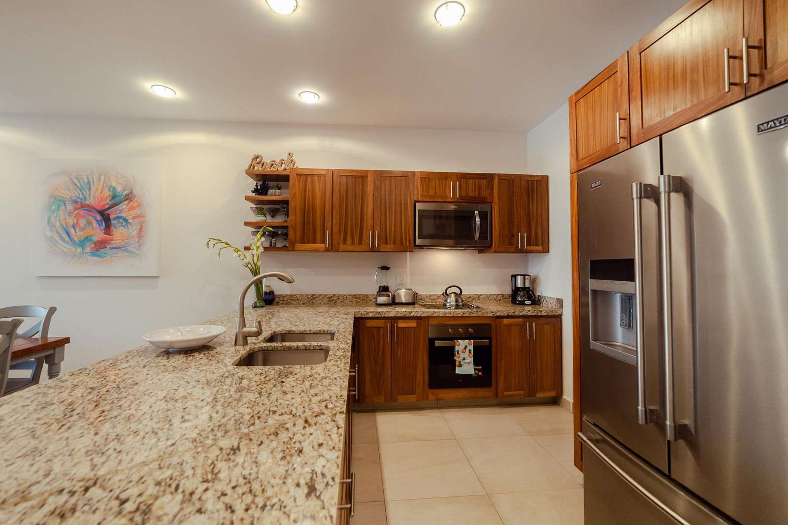 Fully equipped kitchen with stain steel appliances & granite countertops