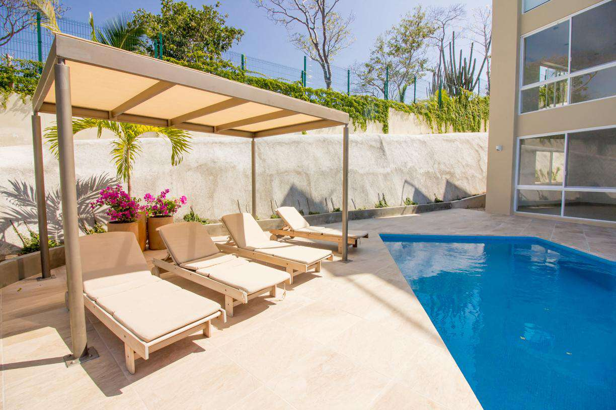 Relax poolside under the shaded palapa