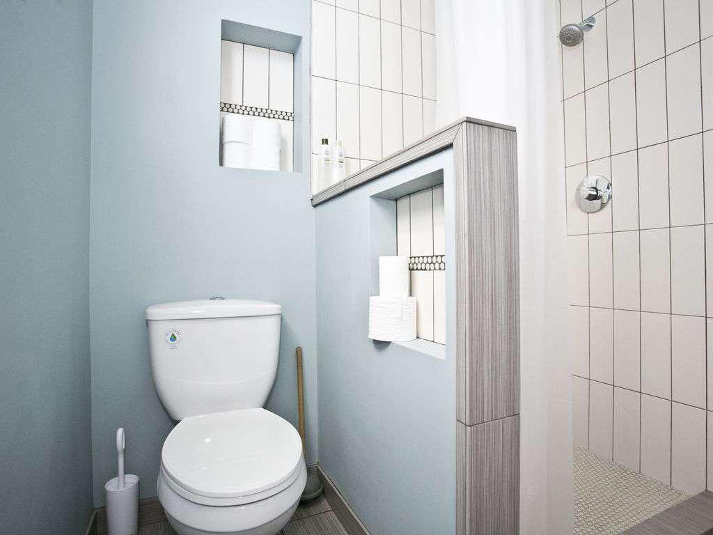Full bathroom on the main floor with beautiful tiled shower.