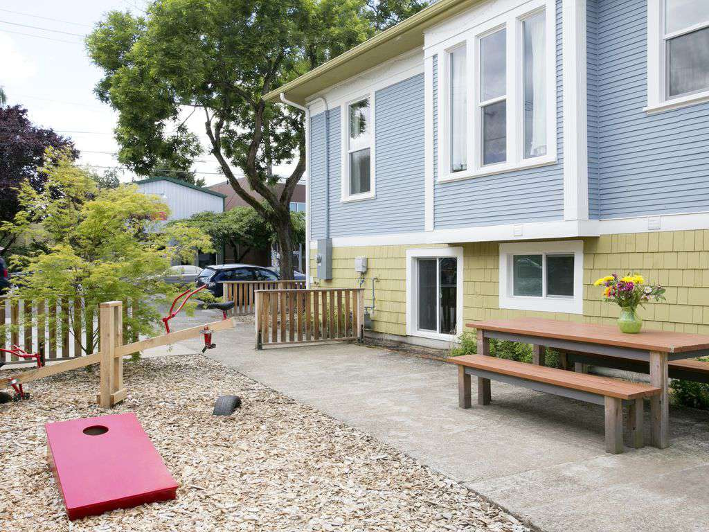 The outdoor space is fantastic. Large picnic table, corn hole and charcoal bbq.