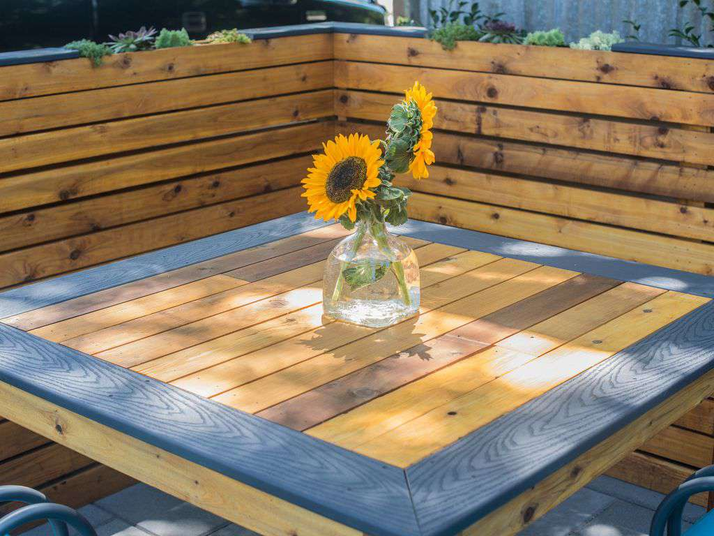 An outdoor picnic table is super fun to hang out and eat meals or share a drink.