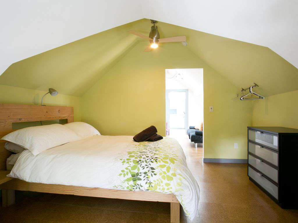 The 4th bedroom is upstairs with a queen bed leading out to a loft  & bathroom