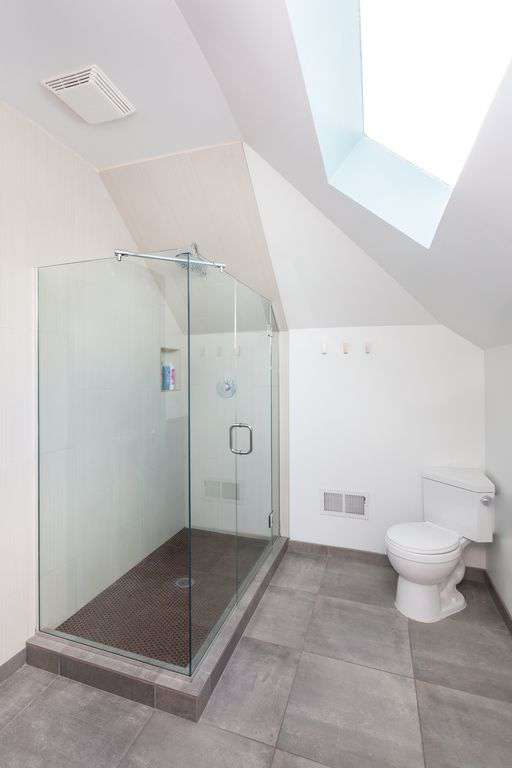 Second floor bathroom- large walk in tiled shower.