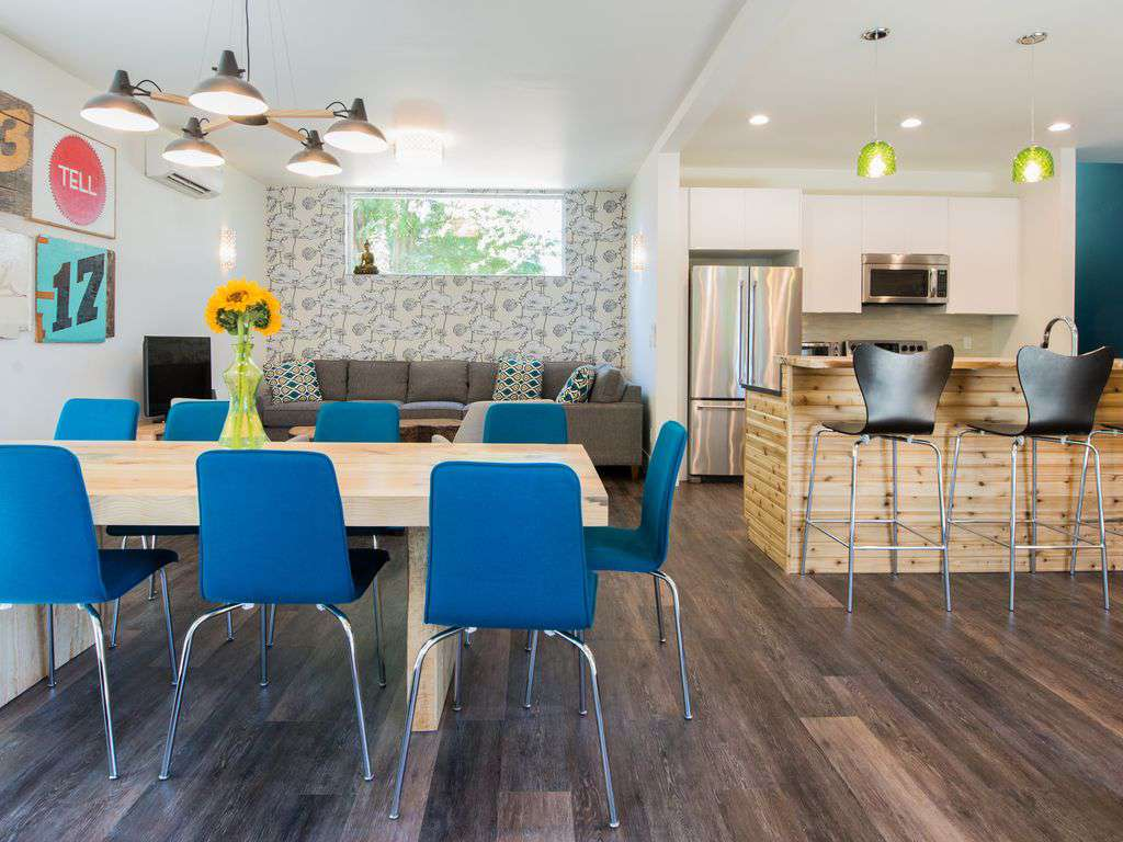 Designer touches, local artwork, & comfortable seating make this house amazing