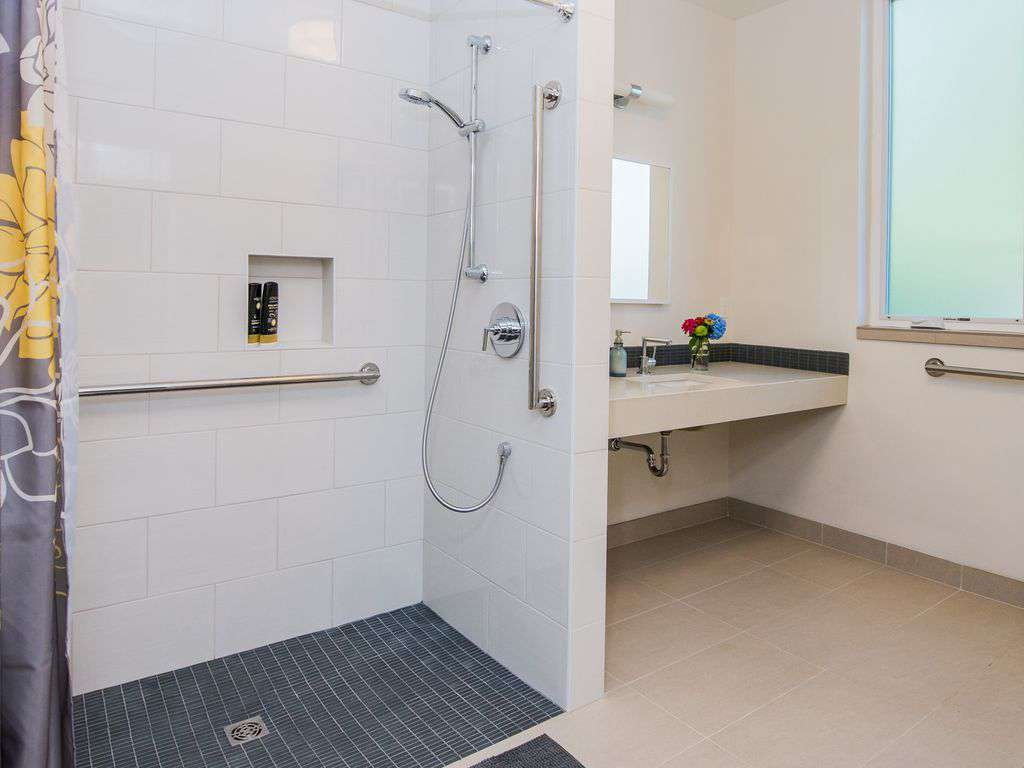 The main floor is all ADA- bathroom has a curb-less entry and grab bars!
