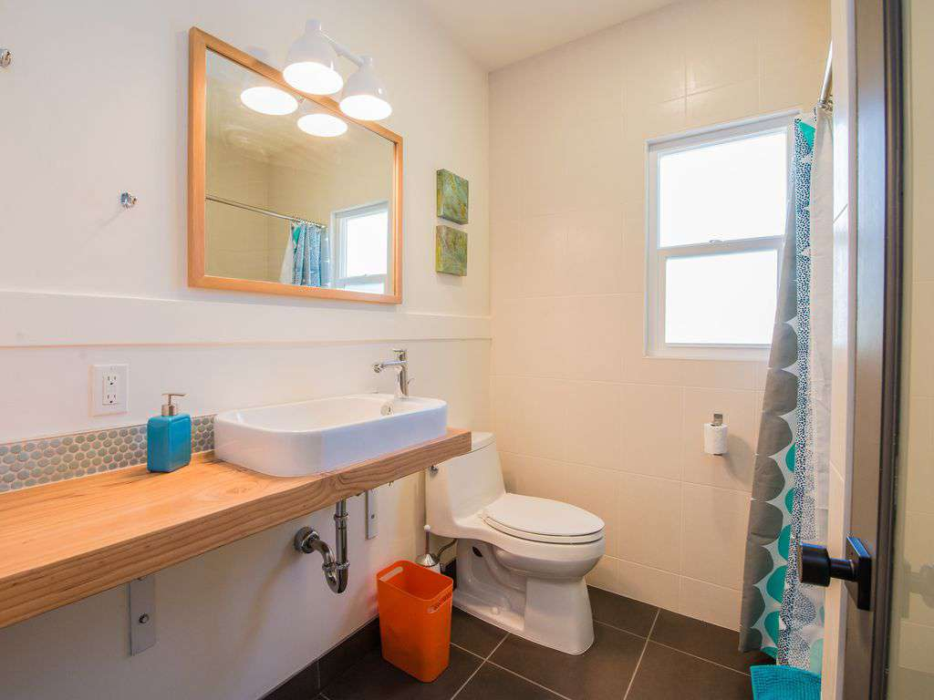 The main floor has a full bathroom with walk in shower and rain shower head.