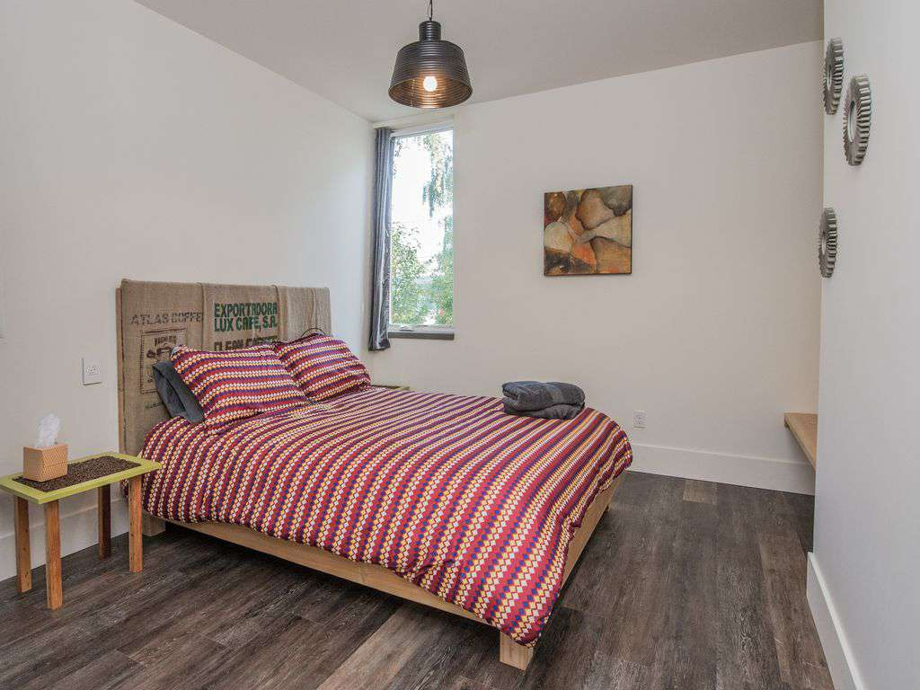 The main floor bedroom is set for ADA- plenty of room and a queen bed.
