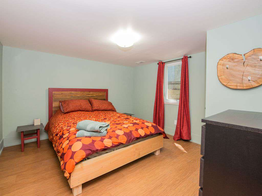 The 3rd bedroom is in the lower level with a queen bed and closet/dresser.