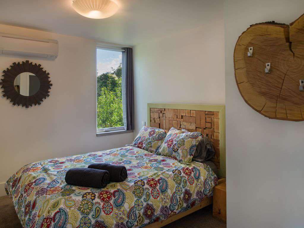 The Forest Room has a queen bed, beautiful view, and luxury linens in all rooms.