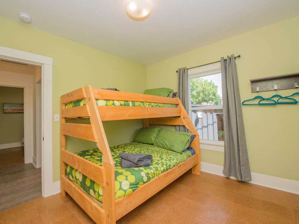 The second bedroom on the main floor has a double down - twin up bunk bed.