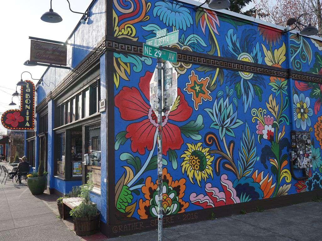Colorful inspiring murals and public art line NE Alberta Arts District.