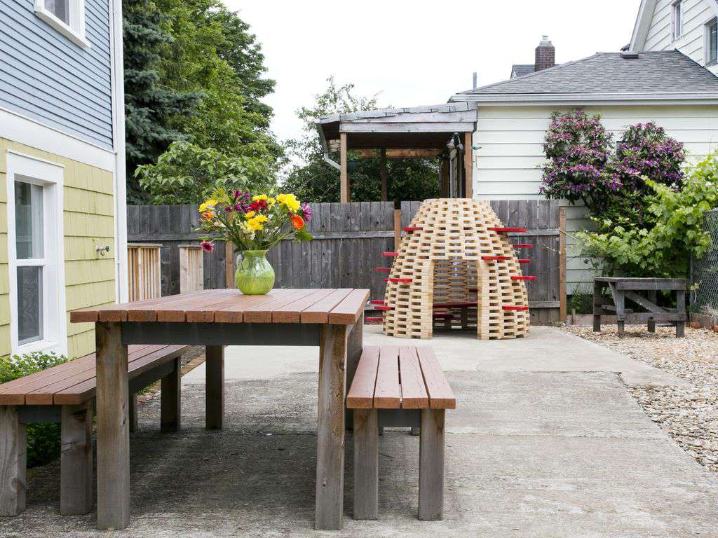 A shared side yard has kids play area with a custom made play hive!