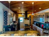 Spacious kitchen with granite countertops and stainless-steel appliances thumb