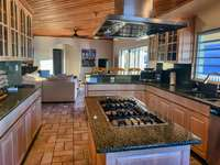 Granite countertops and a large center island thumb