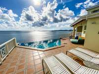 The pool deck, infinity-edge pool, and a view that will never get old! thumb