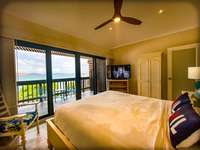 The master bedroom with large sliding glass doors leading out to your private balcony overlooking Sapphire Beach!! thumb