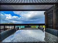 The lower balcony with outdoor seating and fantastic views of Sapphire Beach! thumb