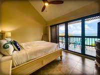 The master bedroom with large sliding glass doors leading out to your private balcony! thumb