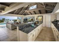 The large kitchen with top-of-the-line appliances and granite countertops thumb