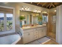 The master bathroom with a large tub thumb