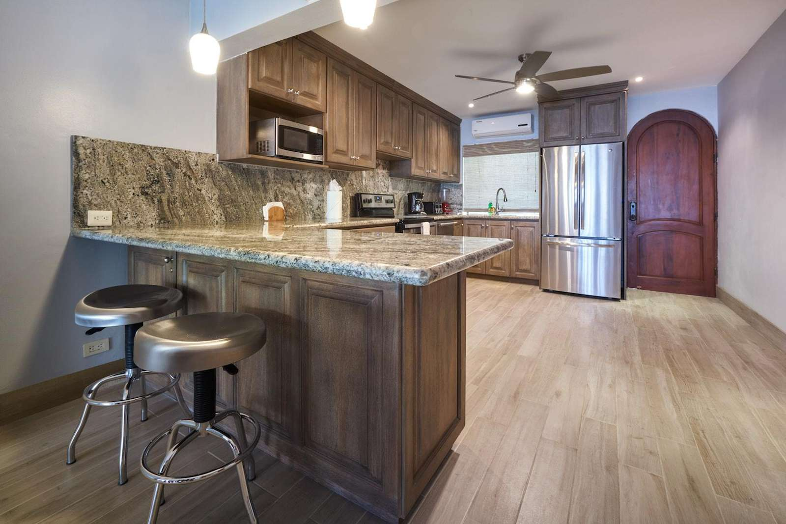Another view of the gourmet kitchen, with breakfast bar