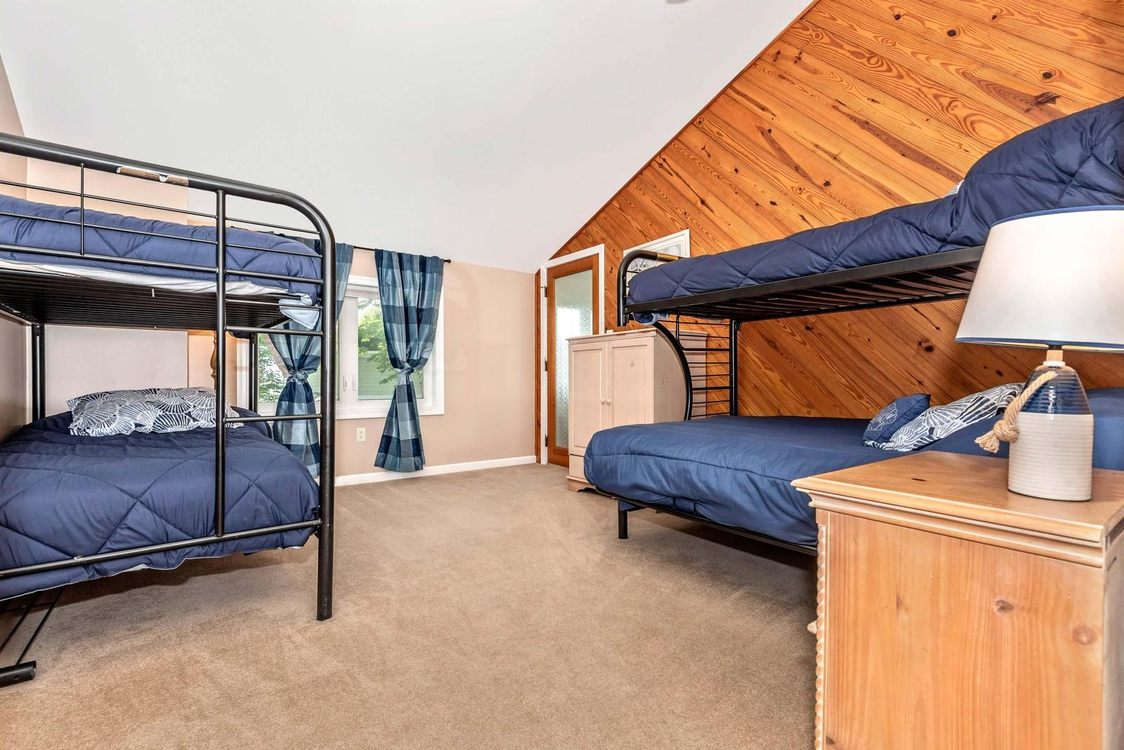 Large master bedroom with 2 bunk beds and bathroom.
