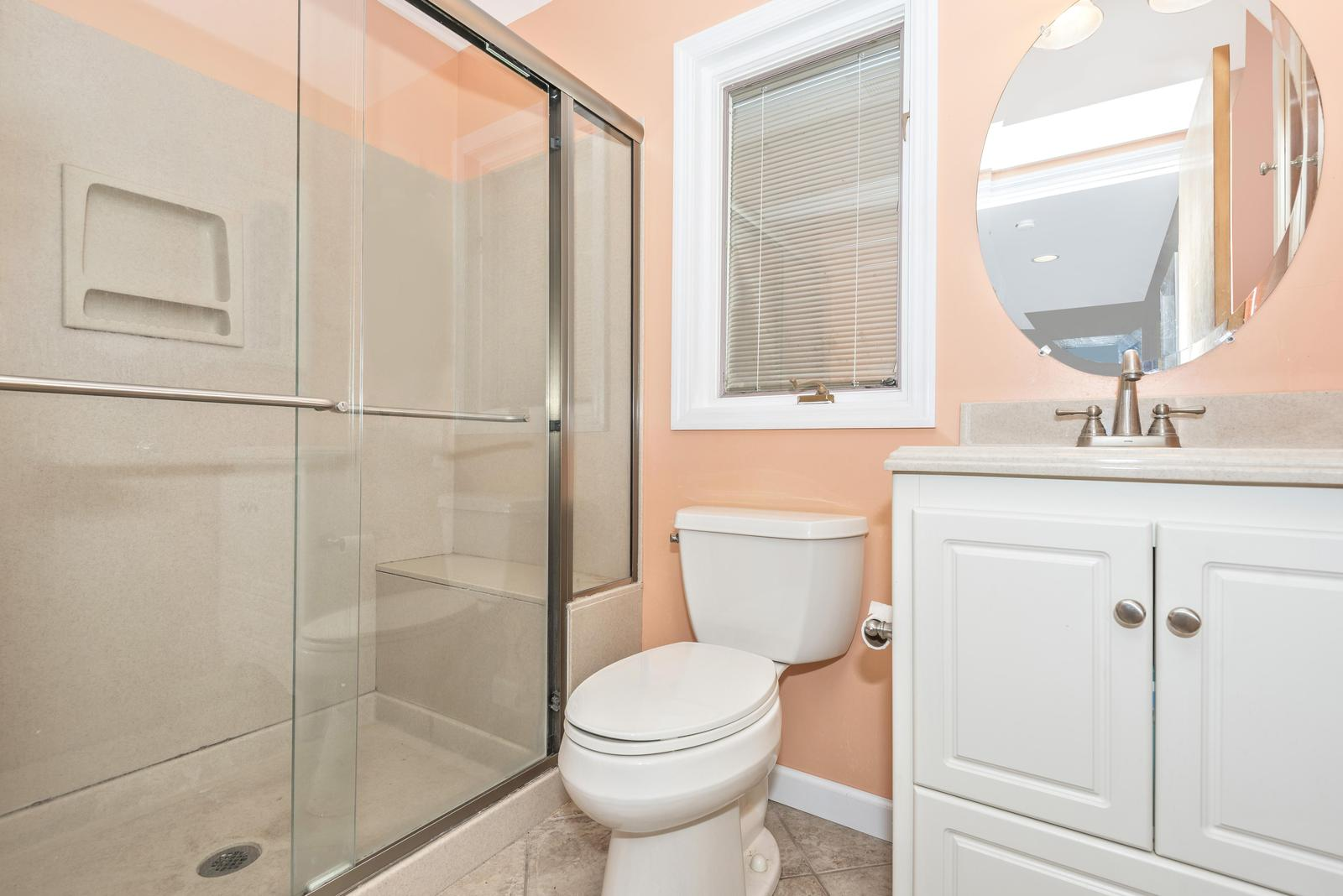 Downstairs bath with stand up shower.