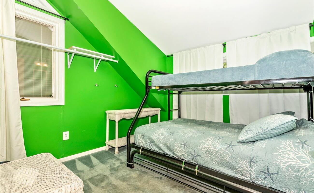 Second upstairs bedroom in East wing with bunk.