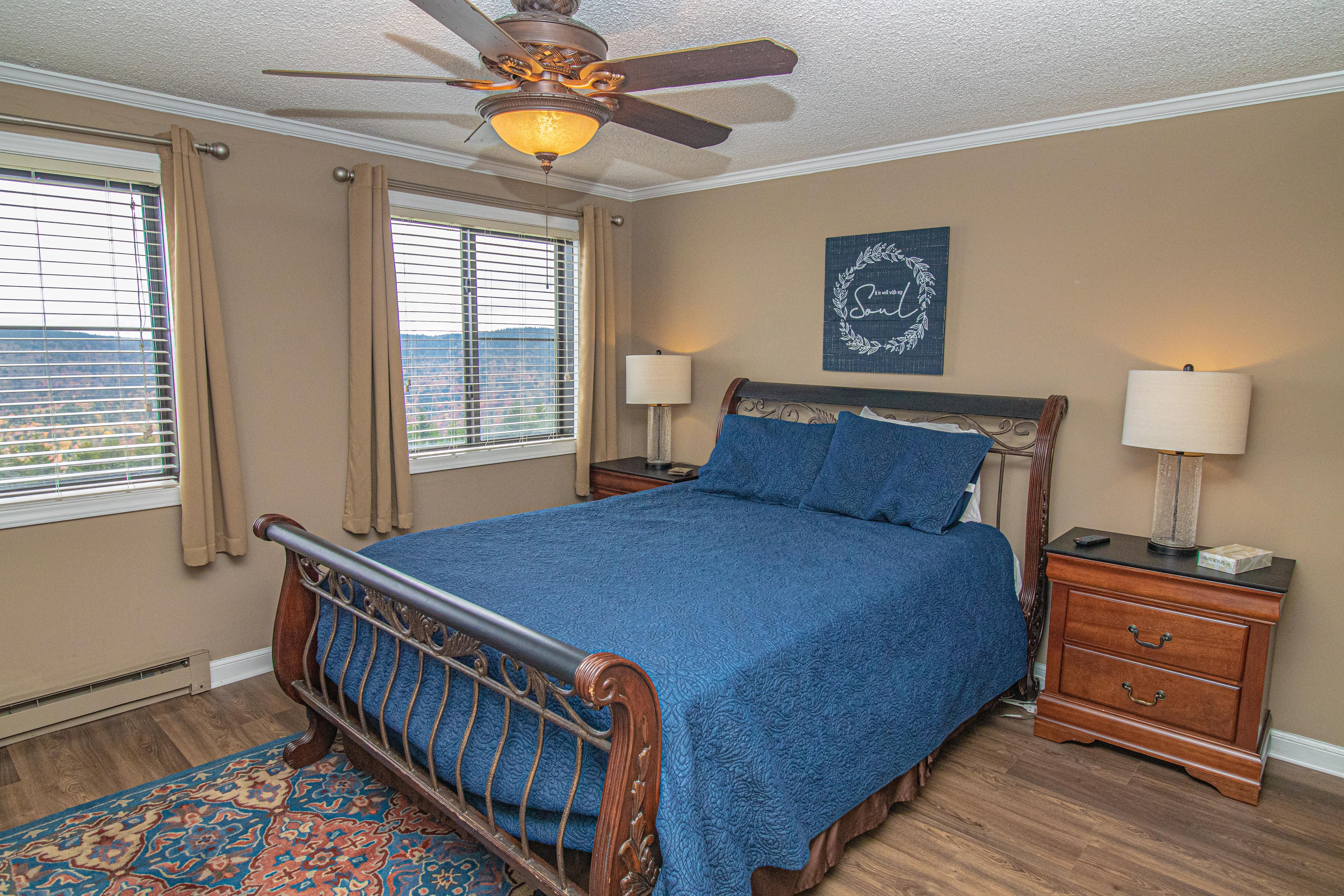 Queen-sized bed in master bedroom. Located on mountain side - NOT the hallway side of bldg!