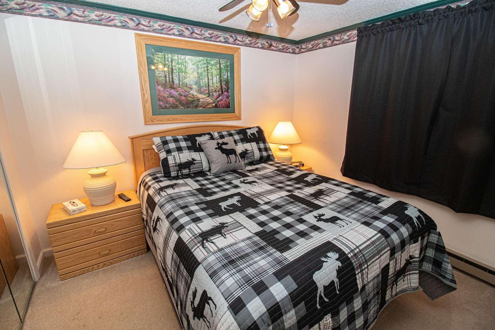 Queen-sized bed in bedroom; Flat Screen TV
