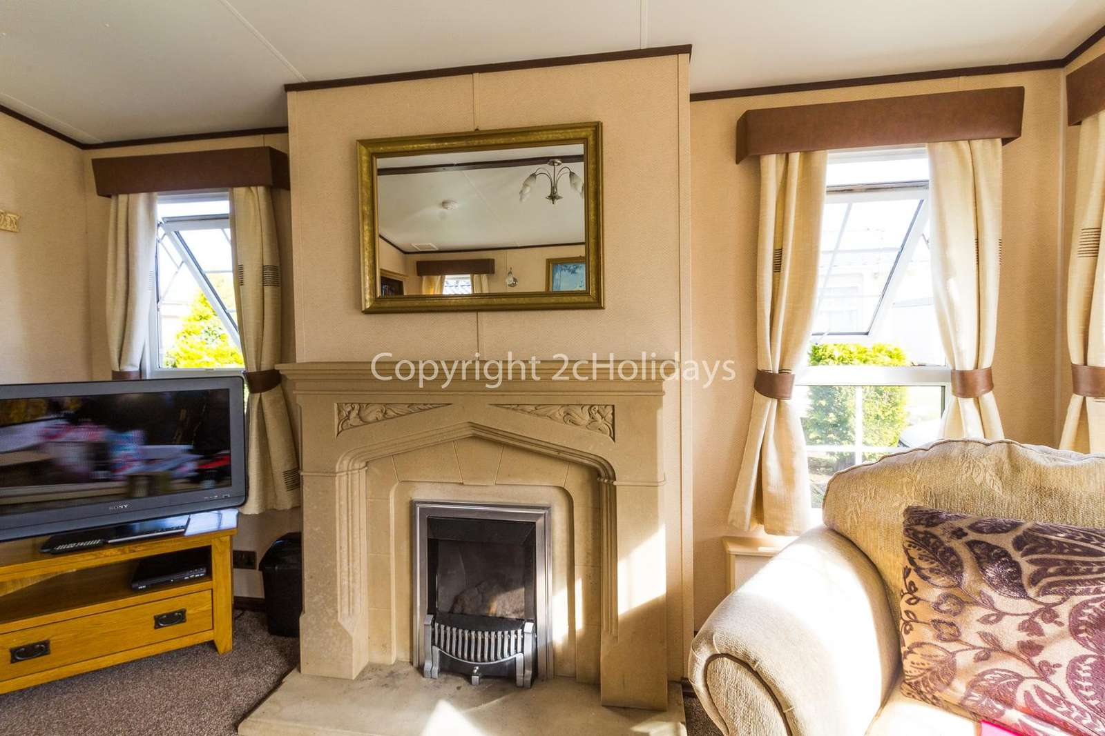 Homely feel to this lounge with a TV and gas fire!