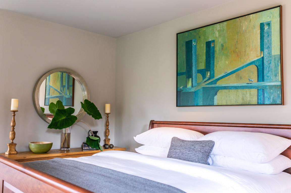 Generous guest room with luxury king bed, spa-inspired en-suite bathroom, flat-screen smart TV, and wonderful city and courtyard views.