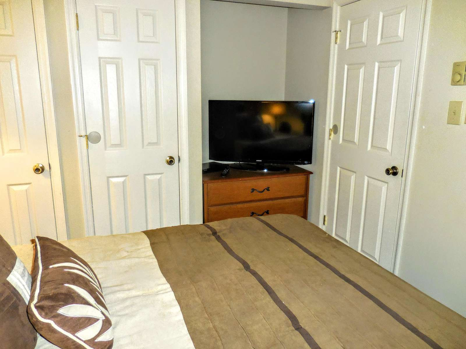 Flat-screen TV and ample closet space in second bedroom.