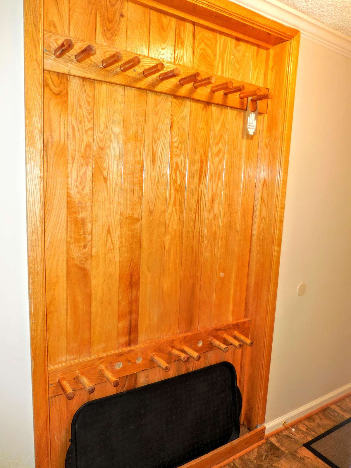 Recessed ski rack in hallway is a perfect location to safely store your gear indoors.