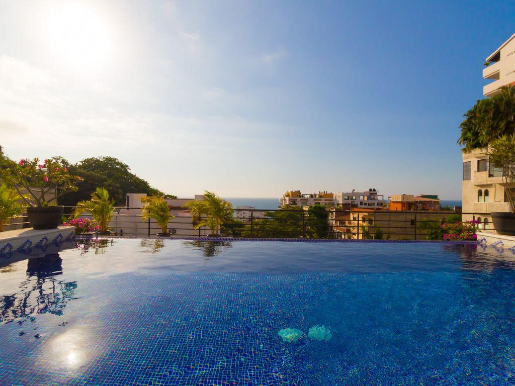 Magnificent ocean, city and mountain views from private infinity pool with jets