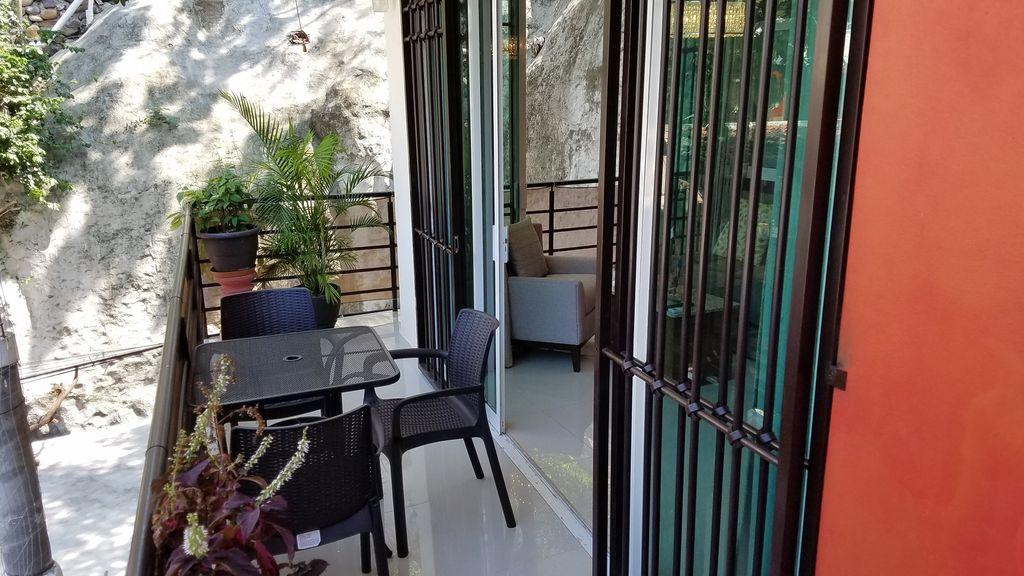Wrap around balcony, table and chairs for your morning coffe