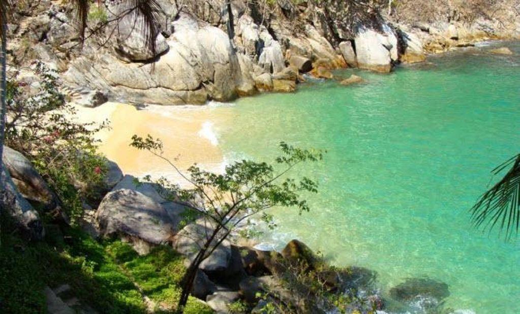 Playa Colomitos water taxi ride from Olas Alrtas pier, 20 minutes away