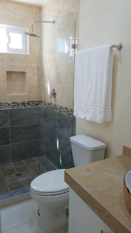 Walk-in tiled shower.