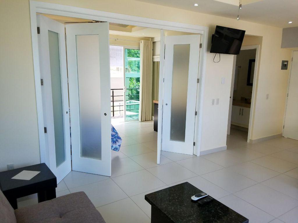 """32"""" flat screen TV in living space and kitchen.  Access to bathroom."""