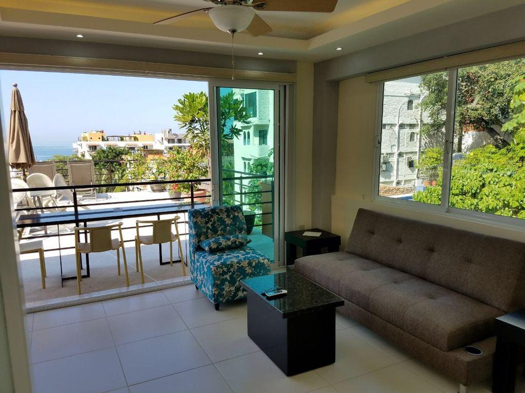 View from bedroom to open air living area. Shades provide privacy when desired.