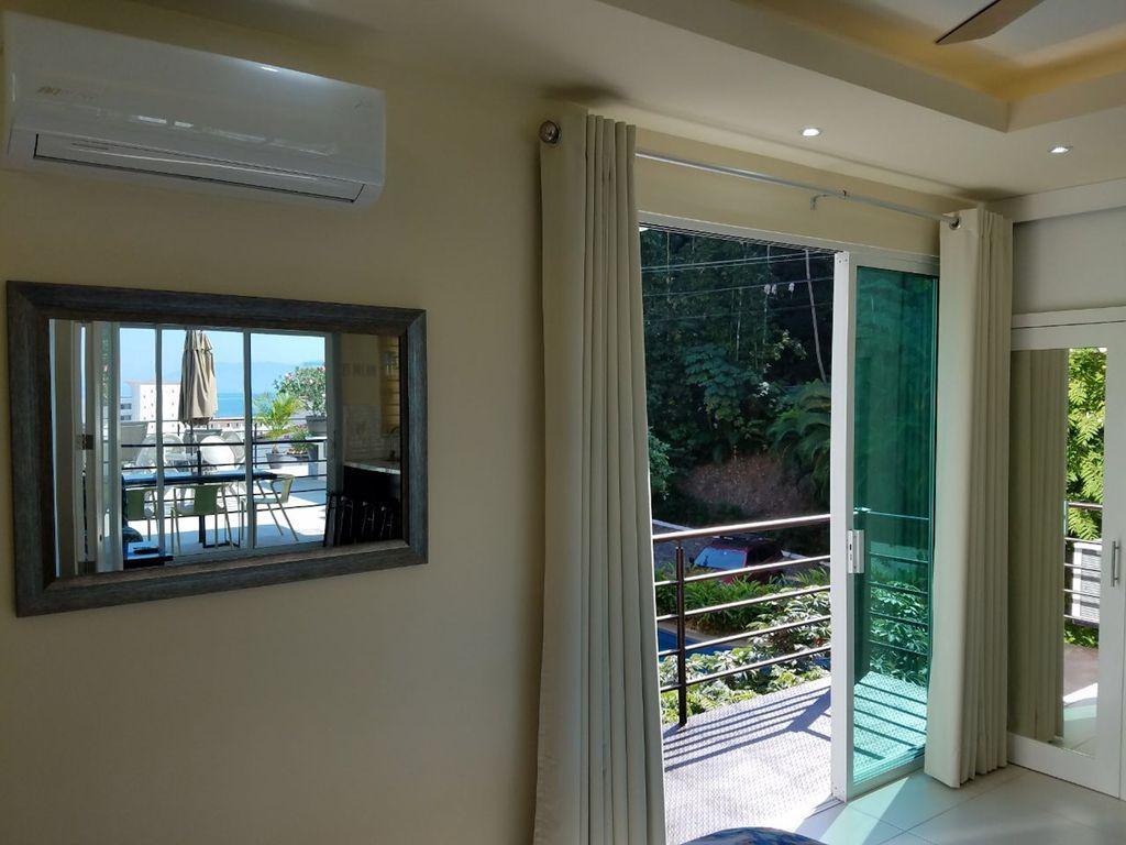 Fully opening sliding doors to bedroom balcony.