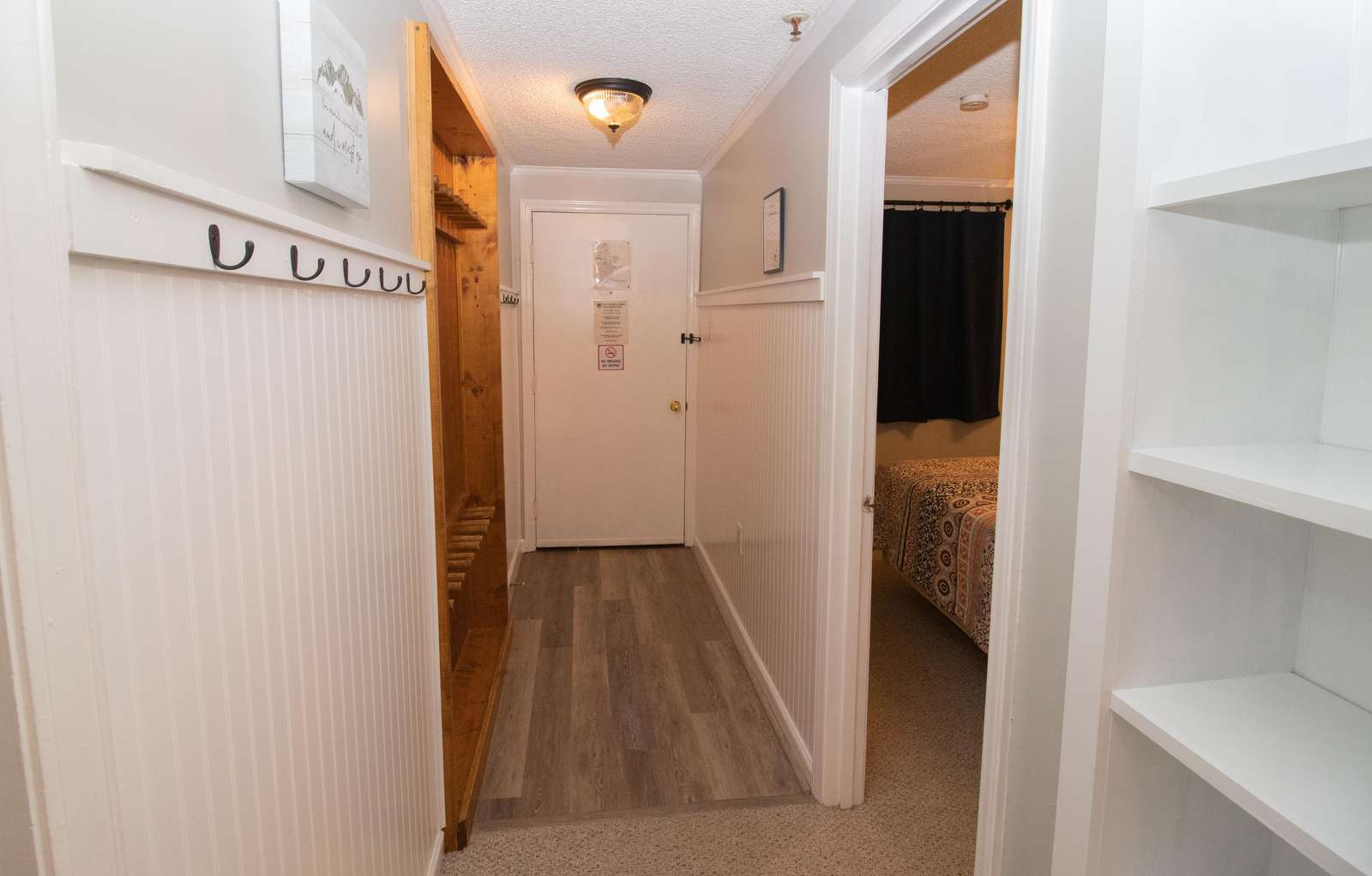 Recessed ski rack in hallway - safely store your gear inside the unit!