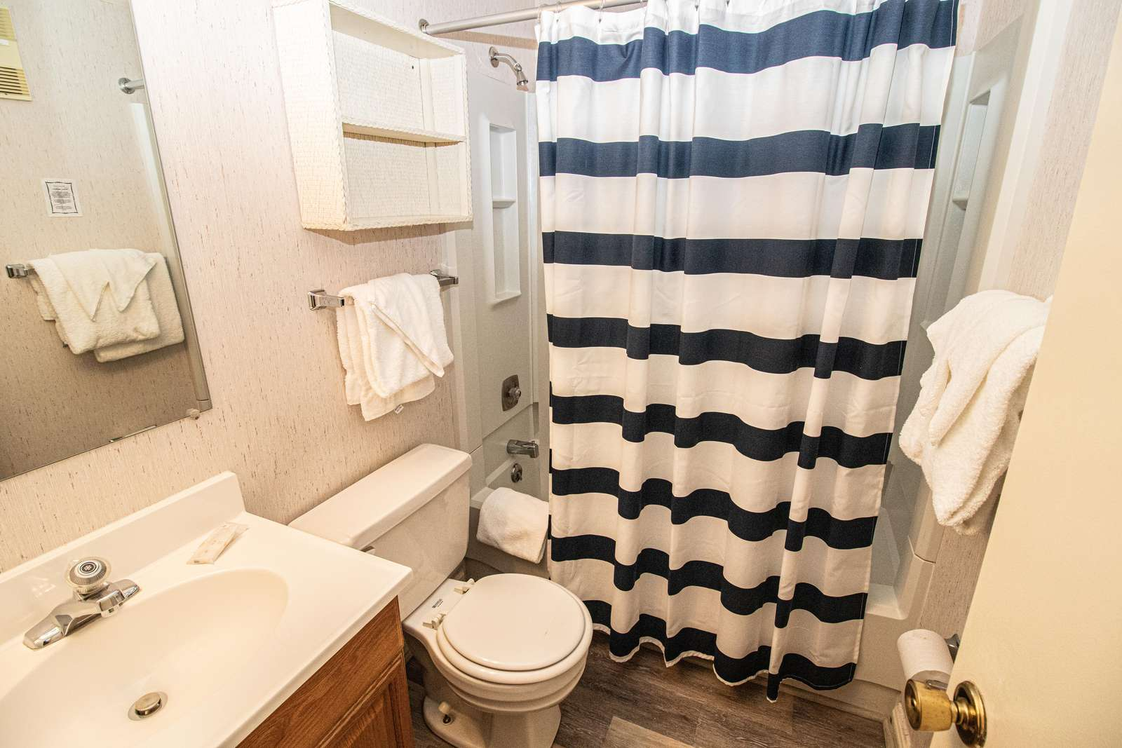 Full-sized second bathroom with tub and shower