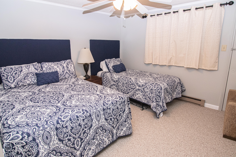 Bedroom 1 includes queen and twin beds
