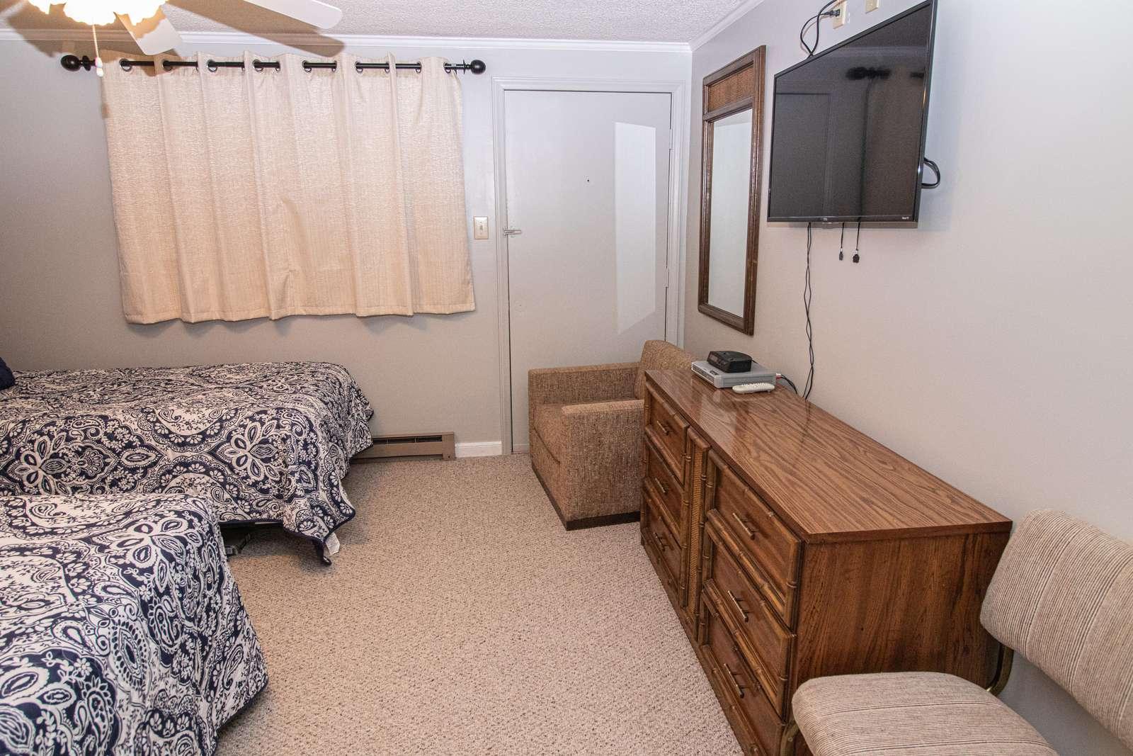 Flat-screen TV in bedroom 1