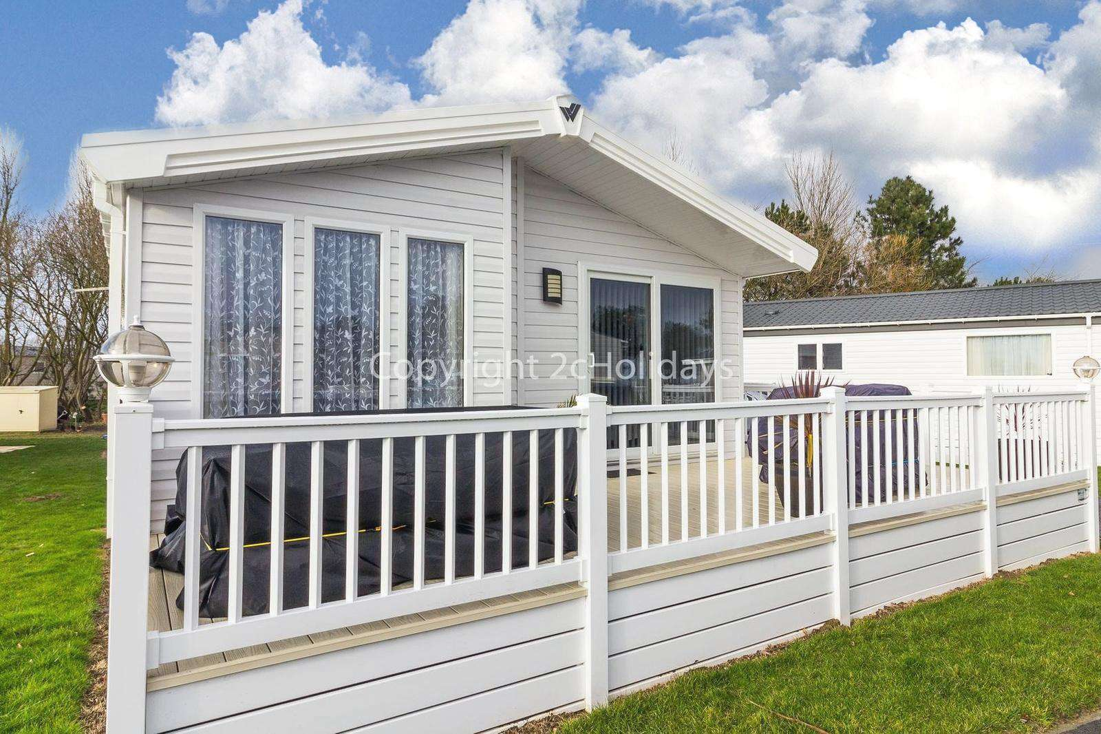 Accommodation with large decking at Park Holidays, Suffolk