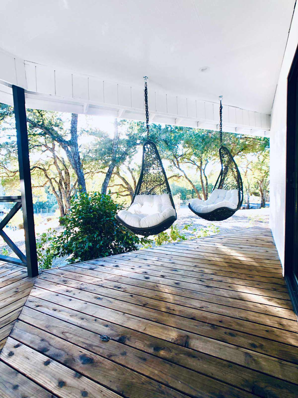Relax in outdoor hanging chairs overlooking pond