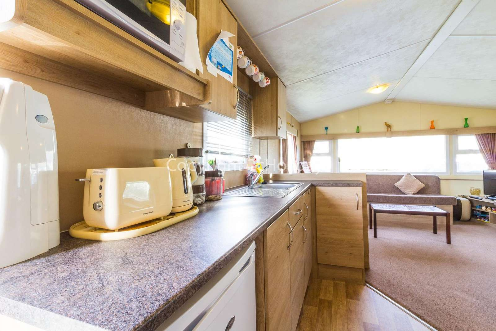 Spacious cooking area with plenty of storage cupboards